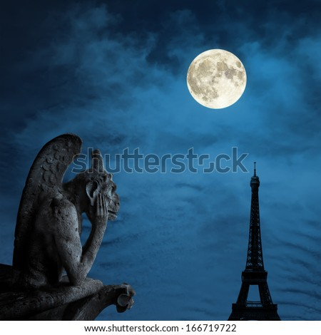 Chimera (demon) from a roof of Notre Dame of Paris looking to the Eiffel Tower under moonlight - stock photo