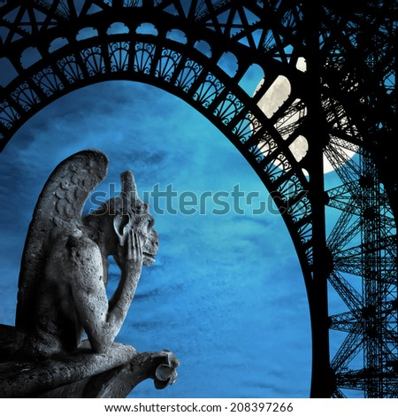 Chimera (demon) from a roof of Notre Dame of Paris looks at the full moon and Eiffel Tower profile - stock photo
