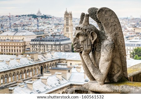 Chimera (gargoyle) of the Cathedral of Notre Dame de Paris overlooking Paris, France - stock photo