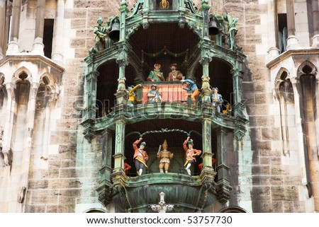 chimes in munich city hall and facade - stock photo