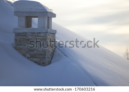 chimney covered by snow in  winter - stock photo