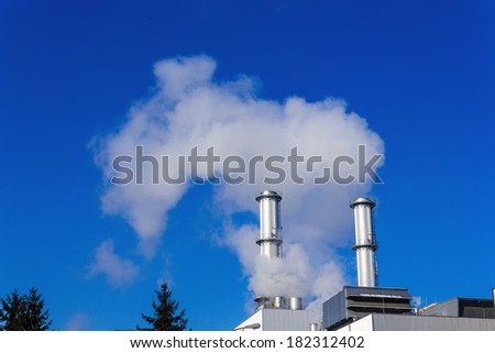 chimney of an industrial company a wake smoke. symbolic photo for environmental protection and ozone. - stock photo