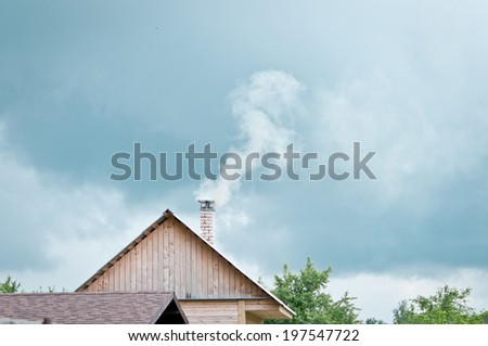 Chimney on the roof /Rural landscape - stock photo