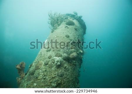 Chimney on world war II shipwreck in Coron area, Palawan, Philippines. - stock photo