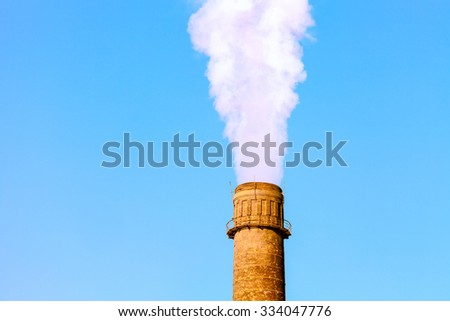 Chimney smoke with blue sky. The global