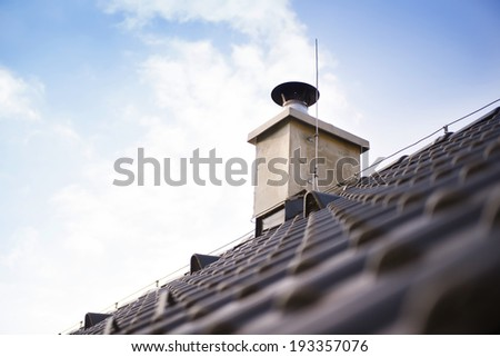 Chimney stack and concrete roofing on the new building - stock photo