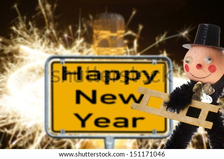 Chimney sweep with champagne bottle and sign with the words Happy New Year / new years eve - stock photo