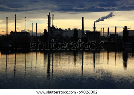 Chimneys in industrial area - stock photo