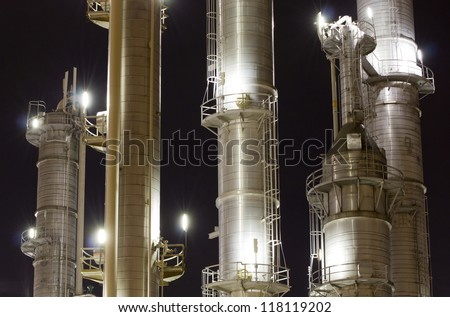Chimneys of an oil-refinery plant - stock photo