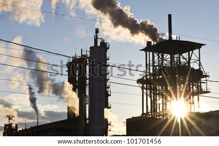chimneys of industrial buildings - stock photo