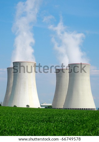 Chimneys of nuclear power plant. View on nuclear power plant in sunny weather. Dukovany, Czech Republic, EU. - stock photo