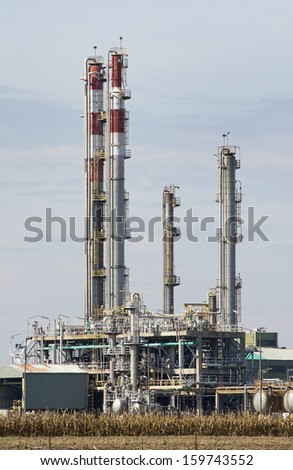 Chimneys of oil refining and gas industry - stock photo