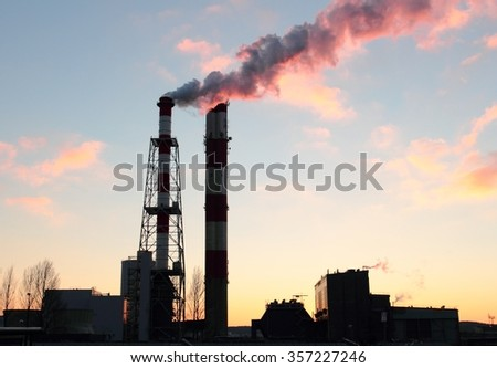 Chimneys of power plant with steam emission to air, Gdynia, Poland - stock photo