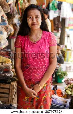 CHIN STATE, MYANMAR - JUNE 18 2015: A lady with thanaka painted face in the Chin State Mountainous Region, Myanmar (Burma) - stock photo