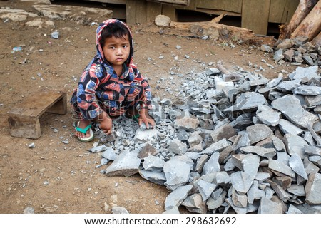 CHIN STATE, MYANMAR - JUNE 22 2015: Child labour in the recently opened for tourists Chin State Mountainous Region, Myanmar (Burma) - stock photo