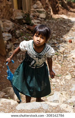 CHIN STATE, MYANMAR - JUNE 18 2015: Cute school girl in the recently opened for tourists Chin State Mountainous Region, Myanmar (Burma) - stock photo
