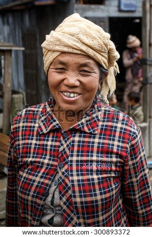 CHIN STATE, MYANMAR - JUNE 23 2015: Friendly lady in village popular for selling apples in the recently opened to foreigners area of Chin State - western Myanmar (Burma) - stock photo