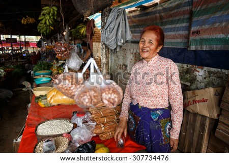 CHIN STATE, MYANMAR - JUNE 18 2015: Lady in marketplace in the recently opened for tourists Chin State Mountainous Region, Myanmar (Burma) - stock photo