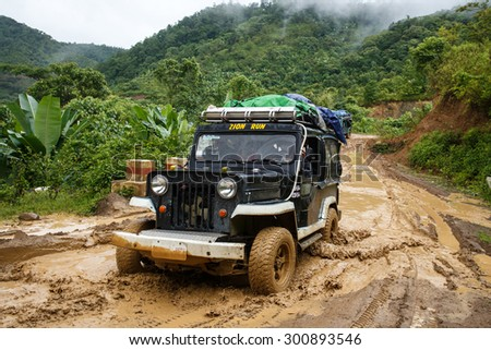 CHIN STATE, MYANMAR - JUNE 22 2015: Offroad Adventure on Dirt Road Leading Through Chin State Mountainous Region, Myanmar (Burma)