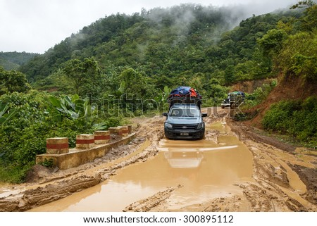 CHIN STATE, MYANMAR - JUNE 22 2015: Offroad Adventure on Dirt Road Leading Through Chin State Mountainous Region, Myanmar (Burma) - stock photo