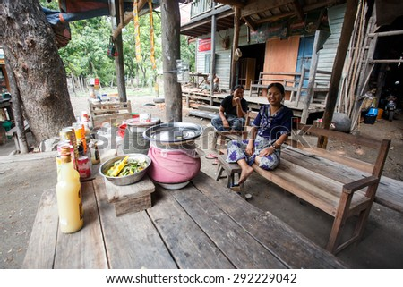 CHIN STATE, MYANMAR - JUNE 16 2015: Two ladies sit in a village in the recently opened to foreigners area of Chin State - western Myanmar (Burma) - stock photo