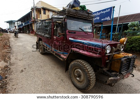 CHIN STATE, MYANMAR - JUNE 18 2015: 4X4 Driving through the recently opened for tourists Chin State Mountainous Region, Myanmar (Burma) - stock photo