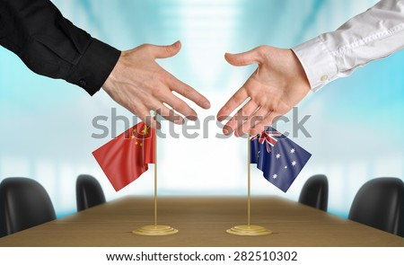 China and Australia diplomats agreeing on a deal - stock photo