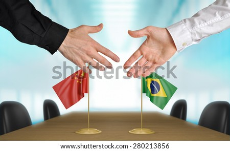 China and Brazil diplomats agreeing on a deal - stock photo
