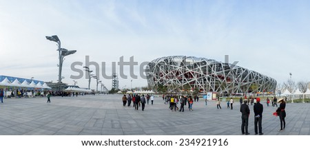 CHINA - APRIL 11: panorama of Tourist walking around Bird Nest China National Olympic Stadium in Beijing,China, 11 April 2012 - stock photo
