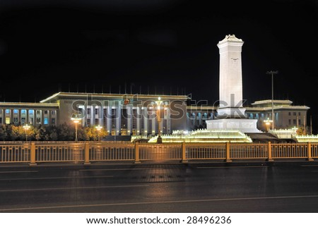 China Beijing Tiananmen square the monument to the Peopleâ??s Heroes and the Great Hall of the People at night. - stock photo