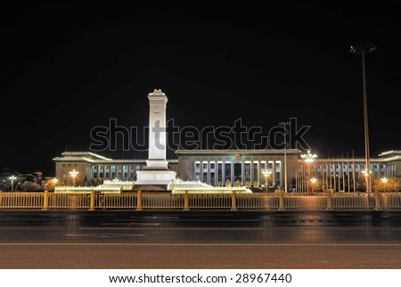China Beijing Tiananmen square the monument to the People's Heroes and the Great Hall of the People at night. - stock photo