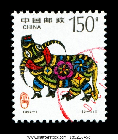 CHINA - CIRCA 1997: A postage stamp printed in China shows 1997 Lunar Year of the Ox.The Ox is one of the 12-year cycle of animals which appear in the Chinese zodiac,circa 1997.  - stock photo