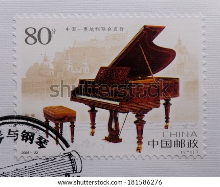 CHINA - CIRCA 2006:A stamp printed in China shows image of China 2006-22 Anicent Zither and Piano Join Issue Austria,circa 2006 - stock photo