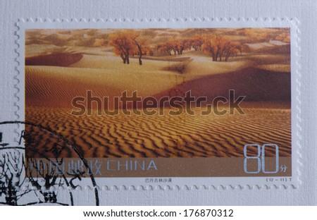 CHINA - CIRCA 2004:A stamp printed in China shows image of China 2004-24 Frontier Scenes of China Stamps Landscape Badain Jaran desert,circa 2004 - stock photo