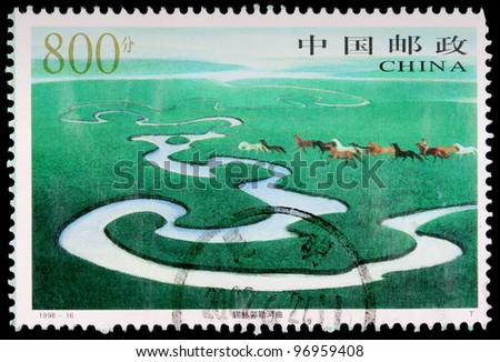 CHINA - CIRCA 1998: An 800-fen stamp printed in the People's Republic of China (PRC) shows a herd of horses at the Xilinguole River Bend of the Xilinguole Grassland in Inner Mongolia, circa 1998