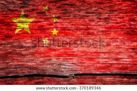 China flag painted on the old cracked wood with worn-out paint. Grunge look.