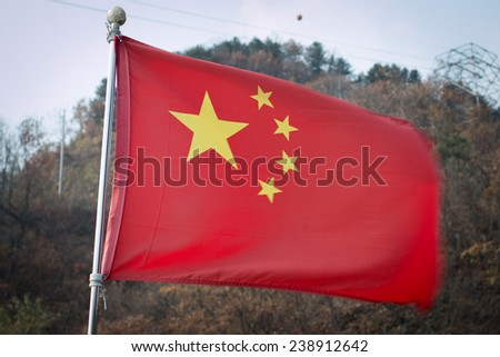 China flag with mountain background. - stock photo