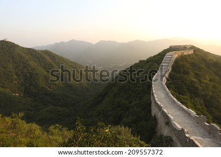 China Great Wall  during sunset in  summer season - stock photo