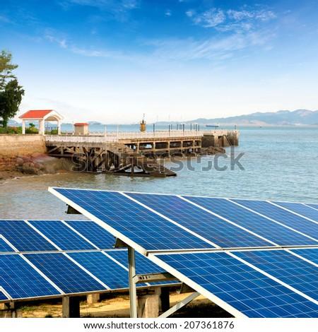 China Gulangyu, solar panels and wind turbines - stock photo