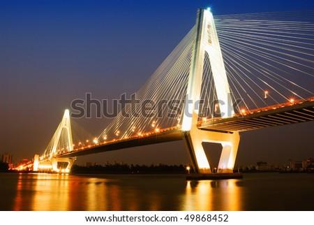 China Haikou Century Bridge Night - stock photo