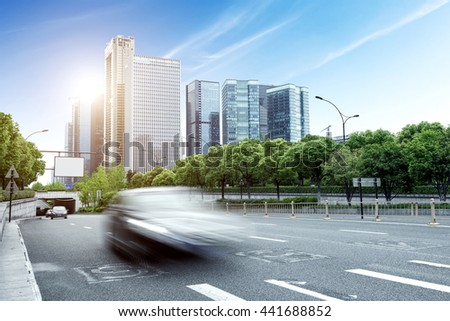 China Hangzhou modern architecture, motion blur car. - stock photo