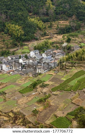 China Hill terraces and villages at the foot of the mountain - stock photo