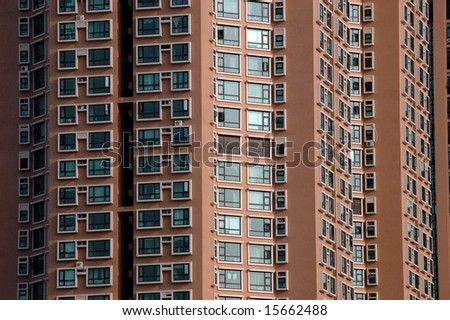China, modern Chinese skyscrapers close photos - visable windows, glass panels, reflections, walls.