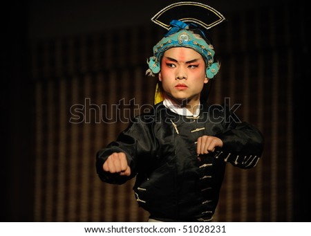china opera actor with hat - stock photo