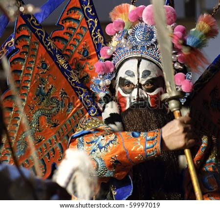 china opera actor with theatrical costume and facial painting - stock photo