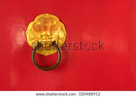 China red door with steel door knocker, this have space for text - stock photo