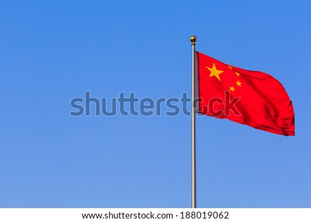 China red flag on blue sky background - stock photo