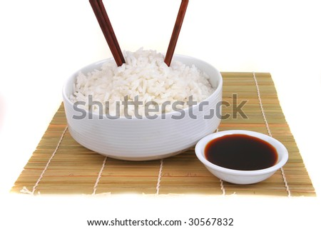 china rice on traditional bamboo mat with soy sauce - stock photo