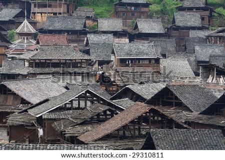 China's ethnic minorities living in Guizhou house. - stock photo