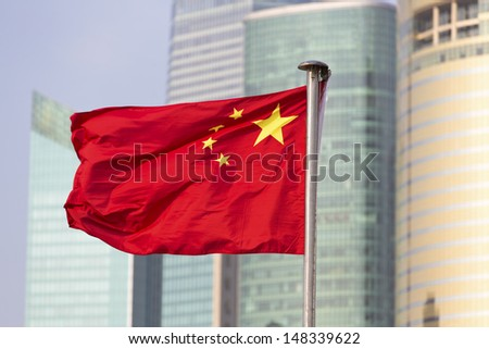 China's flag on the background of skyscrapers of Shanghai World Financial Center  - stock photo